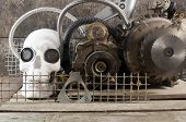 foto of steampunk  - White human skull with mechanical steampunk style metal parts composition on wooden table front view - JPG