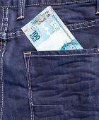 pic of brazilian money  - 100 Brazilian Reais on the jeans pocket - JPG