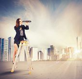 foto of enterprise  - Enterprising businesswoman looking for new job goals - JPG