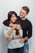 stock photo of multicultural  - A portrait of a happy young multicultural couple - JPG