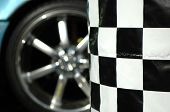 picture of barrel racing  - Checkered flag and spots car wheel - JPG