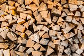 stock photo of firewood  - Dry firewood in a pile for furnace kindling firewood texture - JPG