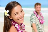 stock photo of hula dancer  - Happy Hawaii couple in Hawaiian lei - JPG