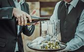 pic of champagne color  - Guests drink champagne on the wedding ceremony outdoor - JPG