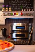 stock photo of take out pizza  - pizza oven and tasty hot pizza on the table - JPG
