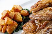 foto of veal  - Veal a la Romana served with diced fried potato and boiled spinach - JPG