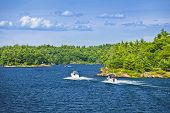 stock photo of recreation  - Recreational boats on blue waters of Georgian Bay near Parry Sound - JPG