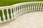picture of posh  - Fancy marble railing on ceramic tile patio with lawn - JPG
