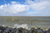 foto of barge  - Barge sailing in a stormy lake in spring - JPG