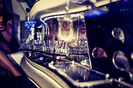 stock photo of champagne color  - Glasses in limo at hen-party with champagne ** Note: Shallow depth of field - JPG
