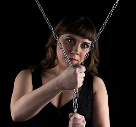 image of curvy  - Photo of curvy woman squeezed chains on black background - JPG