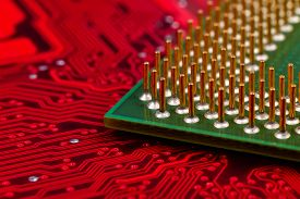 stock photo of cpu  - computer cpu chip on red mainboard extra close up - JPG