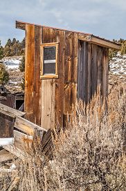 picture of outhouse  - Outhouse in a ghost town that someone has updated with a new window - JPG