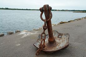 stock photo of anchor  - Old anchor on a pier in a port marine sailing background image - JPG