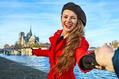 Traveller Woman Holding Friends Hand And Pointing At Notre Dame De Paris poster