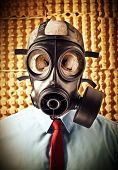 portrait of businessman skull wearing classic gas mask