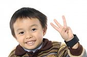 Little asian boy hold 3 fingers up