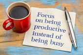 Focus on being productive instead of being busy - handwriting on a napkin with a cup of espresso cof poster