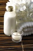 stock photo of massage therapy  - spa concept with orchid and candles  - JPG