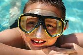 Closeup Headshot Of A Kid In A Diving Mask