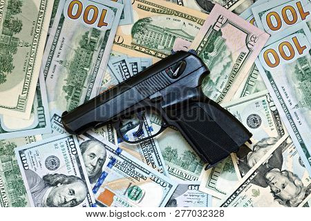 Money And Weapons Gun Against