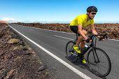 Road bike cyclist man biking riding racing bicycle training for triathlon race. Sports athlete bikin poster