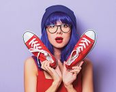 Portrait Of Young Style Hipster Girl With Blue Hair And Red Gumshoes On Purple Color Background poster
