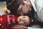 A Young Father Kisses His Newborn Daughter. Father And Newborn Baby Closeup. Father And Newborn Lyin poster