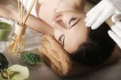 Spa. Face Massage. Spa Skin And Body Care. Close-up Of Young Woman Getting Spa Massage Treatment At  poster