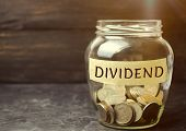 Glass Jar With The Word Dividend. A Dividend Is A Payment Made By A Corporation To Its Shareholders  poster