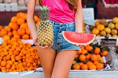 Ananas And Slice Of Watermelon In Hands Of Girl On Tropical Fruits Background. poster
