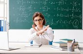 Female math teacher in front of the chalkboard  poster
