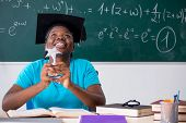 Black female student in front of chalkboard   poster