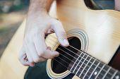 Close Up Of Man Hand Playing Guitar. Man Playing Guitar. Playing On Acoustic Guitar Outdoor poster