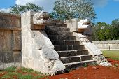 foto of snakehead  - ancient stone temple with snake head in mayan historical site - JPG