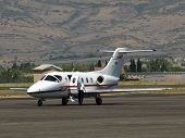 stock photo of cessna  - Cessna private business jet at rural airport with door open - JPG