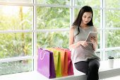 Shopping Asian Woman Laughing Looking At The Screen Of Her Portable Device. Asian Woman Looking Shop poster