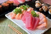 Mixed Sliced Fish Sashimi In White Plate. Sashimi Salmon And Tuna Set With Tuna, Flying Fish Roe Cav poster