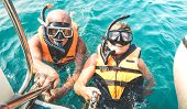 Retired Couple Taking Happy Selfie In Tropical Sea Excursion With Life Vests And Snorkel Masks - Boa poster