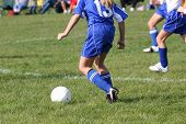 Teen Soccer Player On Field