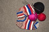 Knitted Wool Socks.background Knitting Wool Socks Spokes. poster