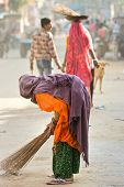 picture of shakti  - Indian woman cleaning the street Rajasthan India - JPG