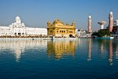 stock photo of granth  - Golden Temple reflection at Amritsar Punjab India - JPG