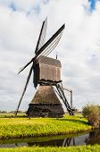 Side View Dutch Windmill In Autumn
