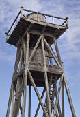 stock photo of mendocino  - Old wooden water tower against a blue sky is Mendocino - JPG