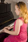 Little Girl Is Playing The Piano