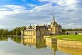 pic of chateau  - Castle of Chantilly at sunset - JPG