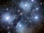 stock photo of planetarium  - open star cluster in the constellation of Taurus - JPG