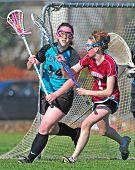 Girls Varsity Lacrosse Sending The Ball Down Field