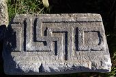 image of swastika  - Old swastika on ruins of Kaunos near Dalyan Turkey - JPG
